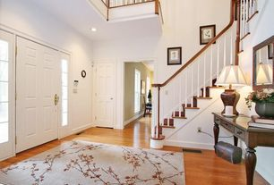Traditional Entryway with High ceiling, Hardwood floors, Loft