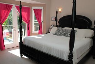 Traditional Master Bedroom with Wall sconce, French doors, Carpet