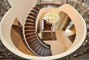 Traditional Staircase with Casement, Cathedral ceiling, six panel door, Chandelier, Spiral staircase, Hardwood floors