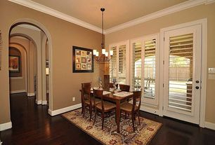 Traditional Dining Room with Pendant light, High ceiling, Crown molding, Hardwood floors, Carpet