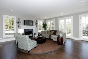 Traditional Living Room with Fireplace, can lights, Standard height, insert fireplace, Hardwood floors, French doors