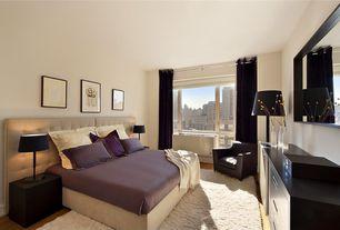 Modern Guest Bedroom with Floor lamp, Dresser, Shag area rug, Carpet, Upholstered headboard, Area rug