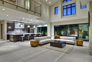 Contemporary Great Room with Concrete floors, Shag area rug, Cathedral ceiling, Viva Terra Convertible Wood Cube, Bar stools