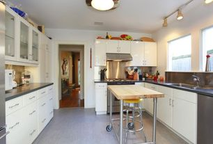 Traditional Kitchen with Stainless Steel, Concrete floors, Flat panel cabinets, Soapstone counters, Kitchen island, Flush
