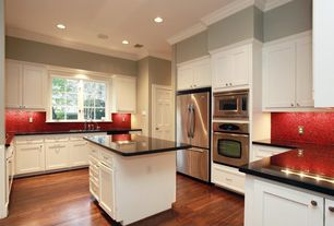 Modern Kitchen with six panel door, Paint 1, Simple marble counters, L-shaped, can lights, Penny Tile, built-in microwave