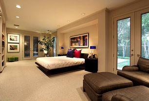 Modern Guest Bedroom with Built-in bookshelf, Standard height, Carpet, can lights, Glass panel door, French doors