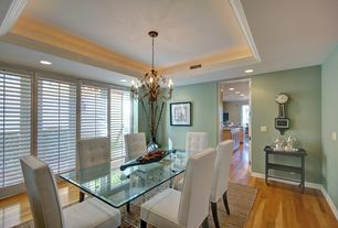 Eclectic Dining Room with Carpet, Chandelier, Crown molding, Laminate floors