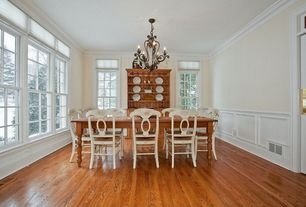 Traditional Dining Room with Laminate floors, Crown molding, Transom window, Wainscotting, Chandelier