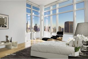 Contemporary Guest Bedroom with Laminate floors, High ceiling