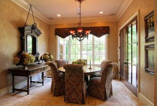 Traditional Dining Room with Chandelier, Crown molding, French doors