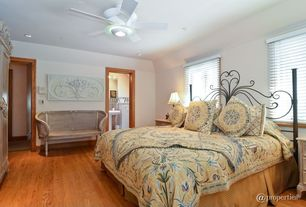 Eclectic Guest Bedroom with flush light, Ceiling fan, High ceiling, Hardwood floors