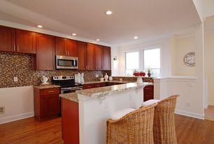 Modern Kitchen with Crown molding, Undermount sink, Flat panel cabinets, Kitchen island, Breakfast bar, Glass Tile, L-shaped