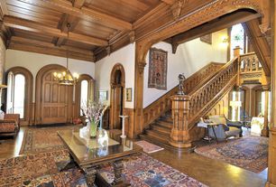 Craftsman Entryway with Arched window, Wainscotting, Concrete floors, Standard height, Chandelier, Box ceiling, Crown molding