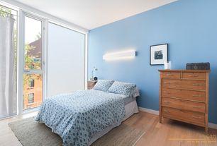Modern Guest Bedroom with Wall sconce, Glass panel door, Hardwood floors