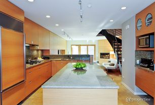 Contemporary Kitchen with French doors, full backsplash, Simple Granite, Standard height, Flush, Undermount sink, U-shaped
