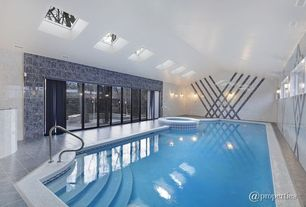 Modern Swimming Pool with Pool with hot tub, exterior tile floors, exterior stone floors, Skylight