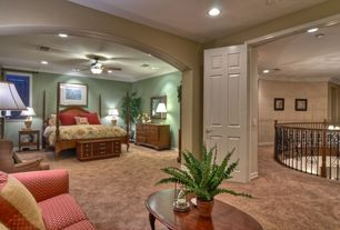 Mediterranean Master Bedroom with Ceiling fan, Carpet, Stained glass window, Crown molding