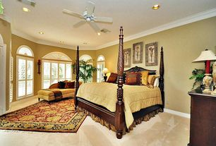 Traditional Guest Bedroom with Carpet, Ceiling fan, Arched window, Crown molding