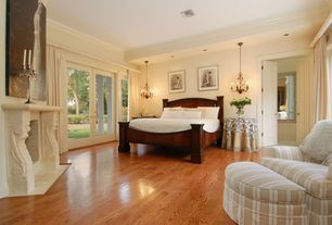 Traditional Guest Bedroom with Crown molding, French doors, Laminate floors, Pendant light, Ceiling fan, Cement fireplace