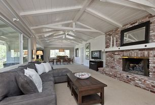Contemporary Great Room with Standard height, picture window, Carpet, Exposed beam, brick fireplace, Fireplace
