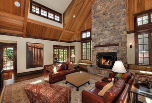 Traditional Living Room with stone fireplace, Laminate floors, Carpet, High ceiling, Window seat, Natural wood framing