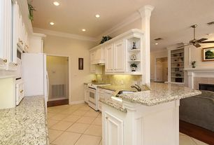 Traditional Kitchen with Undermount sink, Freestanding Full Size Top Freezer Refrigerator, Laminate floors, Crown molding