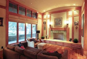 Craftsman Living Room with High ceiling, Hardwood floors, Cement fireplace, Wall sconce