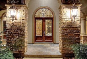 Traditional Front Door with Transom window, Arched window, exterior stone floors, French doors