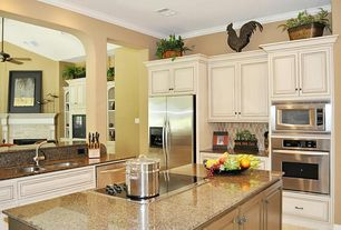 Traditional Kitchen with Oregon Tile and Marble Giallo Fiorito Granite, Undermount sink, Kitchen island, L-shaped