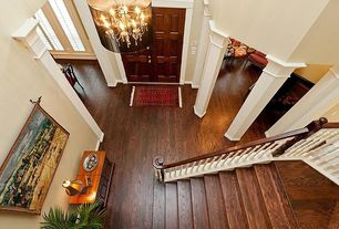 Traditional Entryway with Laminate floors, six panel door, Columns, specialty window, Cathedral ceiling, Carpet, Chandelier