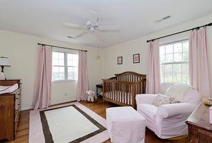 Traditional Kids Bedroom with Hardwood floors, Ceiling fan