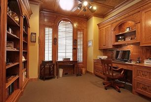 Traditional Home Office with Box ceiling, Carpet, Arched window, Ceiling fan, Crown molding, flush light, Built-in bookshelf