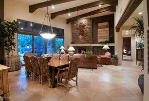 Rustic Great Room with High ceiling, Transom window, Pendant light, Exposed beam, stone fireplace, Built-in bookshelf
