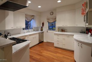 Modern Kitchen with Wall Hood, Flat panel cabinets, built-in microwave, Standard height, Large Ceramic Tile, Casement, Galley