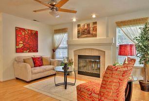 Modern Living Room with flush light, Cement fireplace, specialty window, Bamboo floors, insert fireplace, Standard height