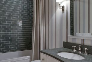 Traditional Full Bathroom with Soapstone, Wall sconce, tiled wall showerbath, interior wallpaper, Undermount sink