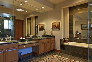 Craftsman Master Bathroom with Frameless, Shower head, stone tile floors, Skylight, Bathtub, Handheld showerhead, Shower