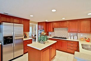 Traditional Kitchen with U-shaped, Raised panel, Large Ceramic Tile, Simple marble counters, Kitchen island, Undermount sink