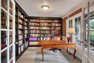 Traditional Home Office with Casement, French doors, Carpet, Standard height, flush light, Built-in bookshelf, Crown molding