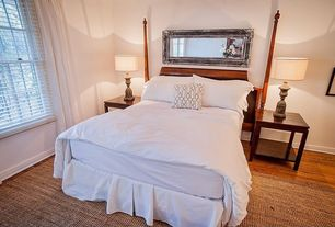 Contemporary Guest Bedroom with double-hung window, specialty window, Standard height, Hardwood floors