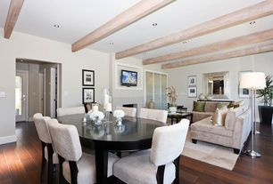 Modern Dining Room with Standard height, Hardwood floors, Fireplace, Exposed beam, can lights