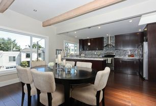 Modern Dining Room with Hardwood floors, can lights, Casement, Exposed beam, High ceiling, picture window