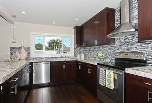 Modern Kitchen with Hardwood floors, Pendant light, Flat panel cabinets, Flush, U-shaped, Destiny: slab cabinets