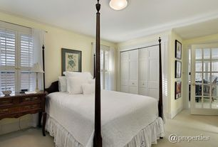 Traditional Guest Bedroom with flush light, French doors, Carpet
