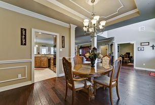 Traditional Dining Room with Wainscotting, Hardwood floors, Chandelier, Chair rail, Crown molding
