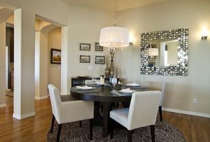 Contemporary Dining Room with Wall sconce, Pendant light, High ceiling, Carpet, Hardwood floors, Columns