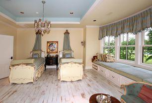 Traditional Guest Bedroom with Crown molding, Hardwood floors, Chandelier, Window seat