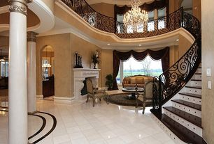 Eclectic Hallway with Fireplace, Columns, Chandelier, Crown molding, Cathedral ceiling, insert fireplace