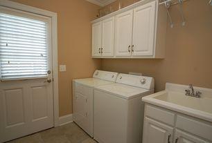 Traditional Laundry Room with Hampton Bay 30x30x12 in. Hampton Wall Cabinet, Built-in bookshelf, terracotta tile floors
