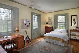 "Cottage Guest Bedroom with Hardwood floors, 52"" Casa Trilogy White Ceiling Fan, Chestnut 4-drawer Single Pedestal Desk"